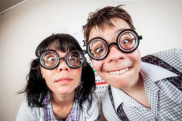 Two person wearing spectacles in an office at the doctor Stock photo © cookelma