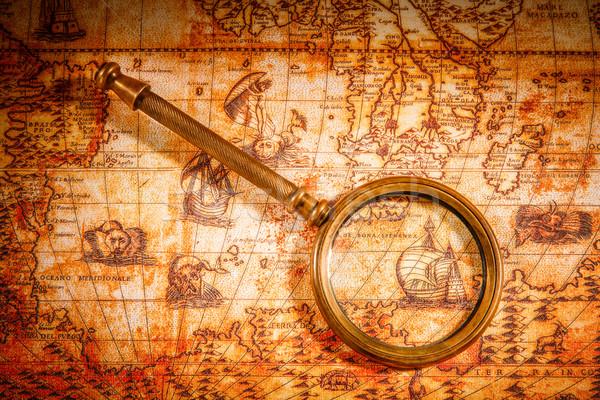 Vintage lupą leży starożytnych mapie świata martwa natura Zdjęcia stock © cookelma