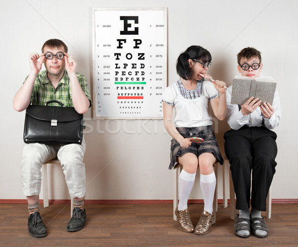 Stock photo: three person wearing spectacles in an office at the doctor