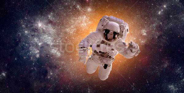 Astronaut de kosmische ruimte achtergrond aarde communie afbeelding Stockfoto © cookelma