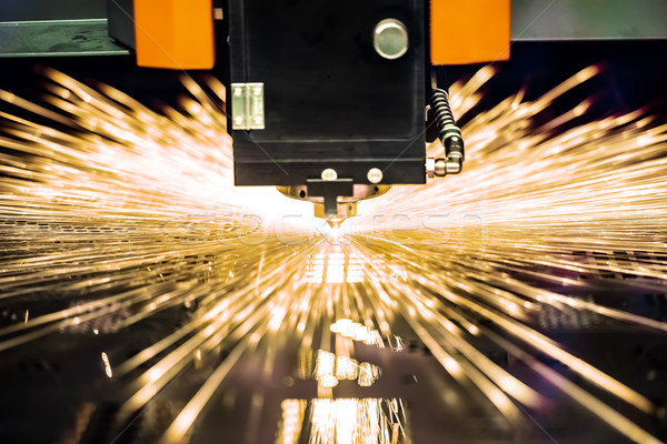 CNC Laser cutting of metal, modern industrial technology. Stock photo © cookelma