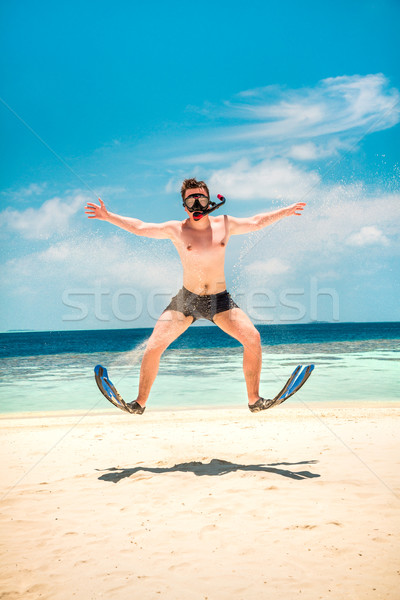 Funny man jumping in flippers and mask. Stock photo © cookelma