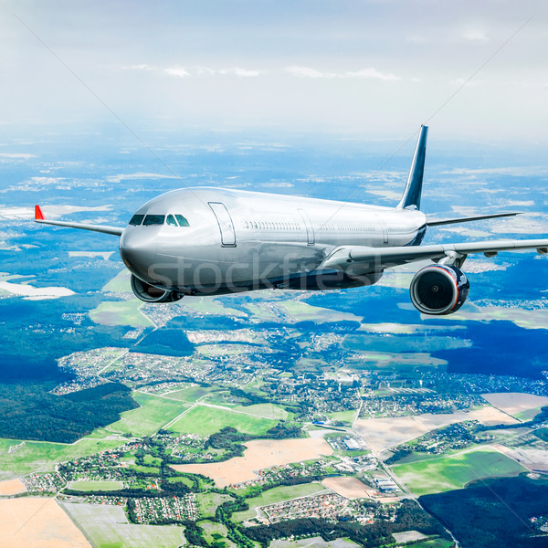 Passenger Airliner in the sky Stock photo © cookelma