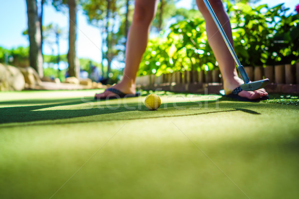 Mini golf amarillo pelota bate puesta de sol Foto stock © cookelma