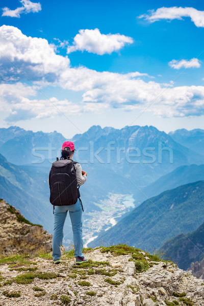 Hiker woman standing up achieving the top Dolomites Alps. Stock photo © cookelma