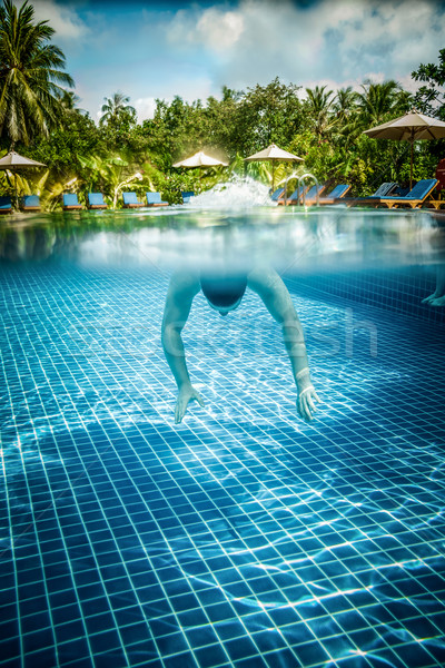 Stock photo: Man floats underwater in pool