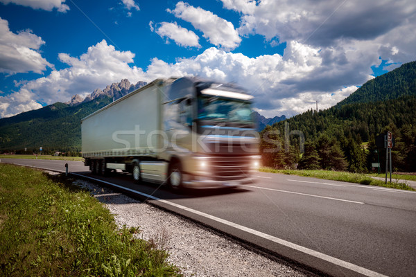 Fuel truck rushes down the highway in the background the Alps. T Stock photo © cookelma