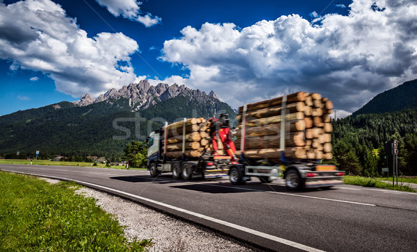 Timber truck rushes down the highway in the background the Alps. Stock photo © cookelma