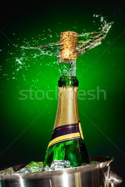 Сток-фото: шампанского · зеленый · льда · бутылку · черный