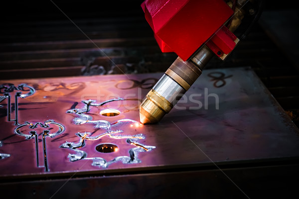 CNC Laser plasma cutting of metal, modern industrial technology. Stock photo © cookelma