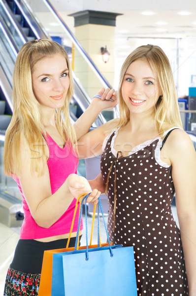 Two girls with bags - comparison shopping. Sale! Stock photo © cookelma