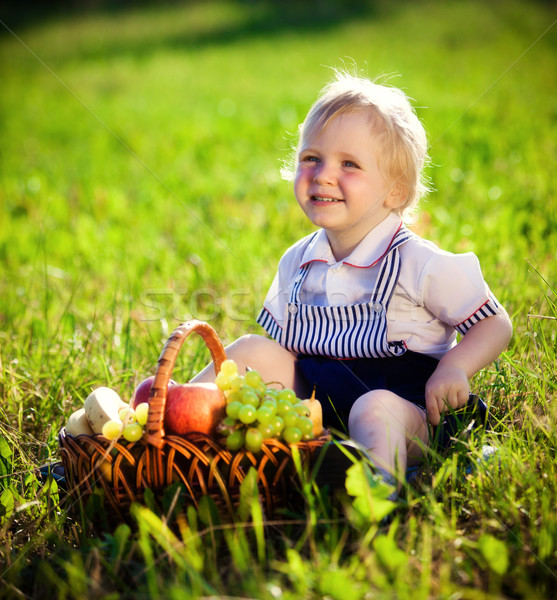 little boy with a basket of fruit Stock photo © cookelma