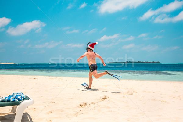 Adam şapka tropikal plaj Noel tatil Stok fotoğraf © cookelma