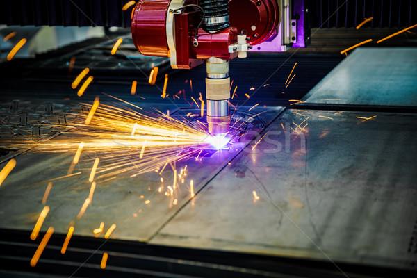CNC Laser plasma cutting of metal, modern industrial technology. Stock photo © cookelma