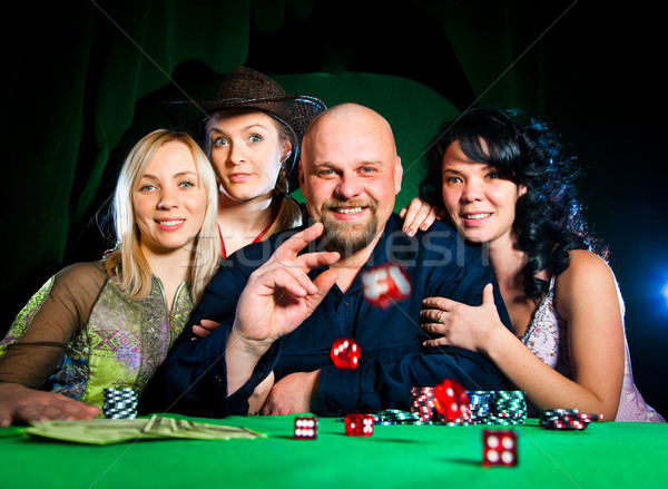 company of friends plays dice Stock photo © cookelma