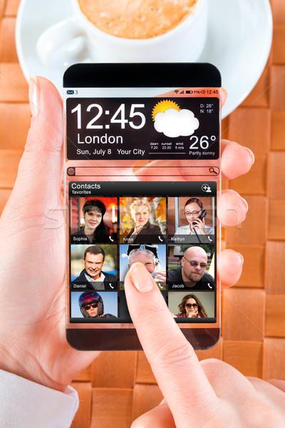 Smartphone transparant scherm menselijke handen Stockfoto © cookelma