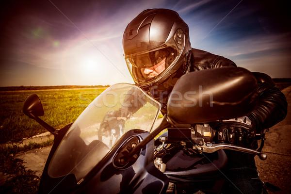 Biker racing on the road Stock photo © cookelma
