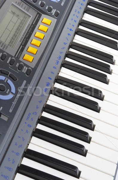 Keys of a musical instrument. Synthesizer. Stock photo © cookelma