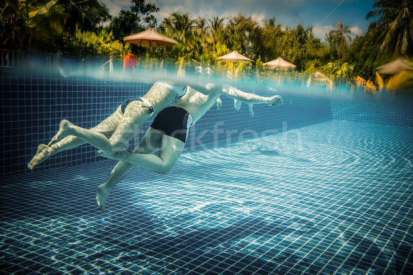 Couple floating in the pool on holiday Stock photo © cookelma