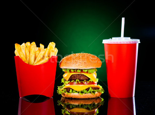 Tasty hamburger and french fries on a dark green Stock photo © cookelma