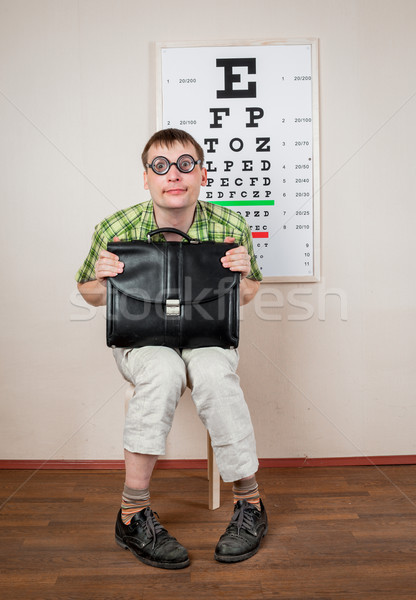 Funny manwearing spectacles in an office at the doctor Stock photo © cookelma