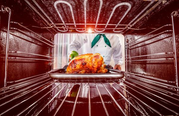 Cuisson poulet four chef poulet rôti vue Photo stock © cookelma