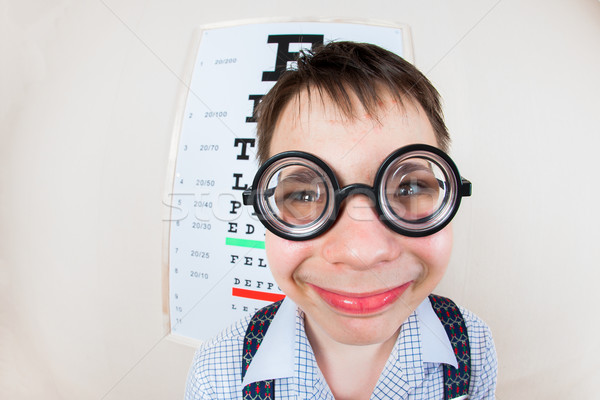 Funny boy wearing spectacles in an office at the doctor Stock photo © cookelma