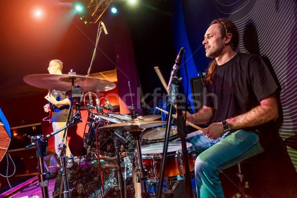 Drummer playing on drum set on stage. Stock photo © cookelma