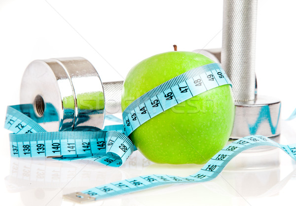 Dumbbells and apple. A healthy way of life Stock photo © cookelma