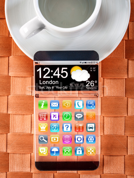 Smartphone with a transparent display. Stock photo © cookelma