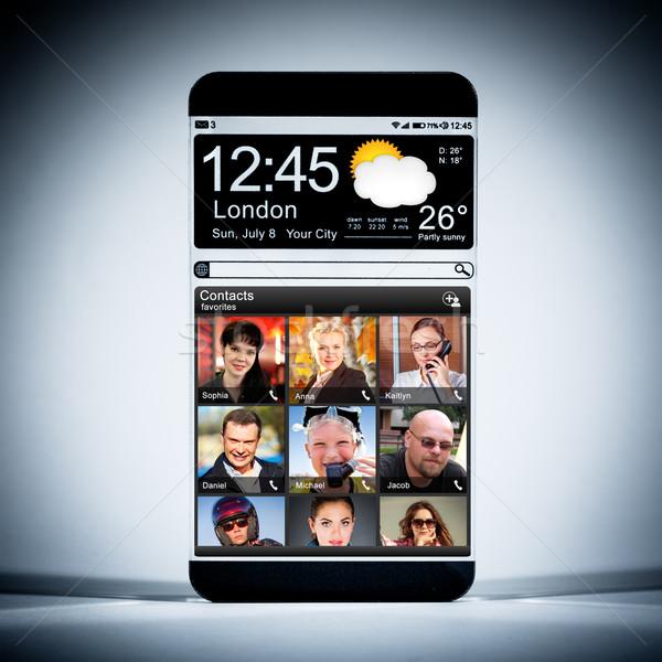 смартфон прозрачный отображения футуристический синий Сток-фото © cookelma