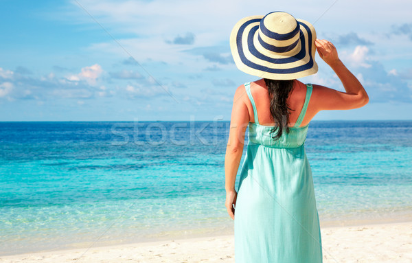 Girl walking along a tropical beach in the Maldives. Stock photo © cookelma