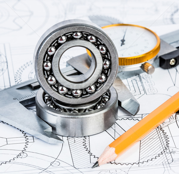 Ball bearings on technical drawing Stock photo © cookelma