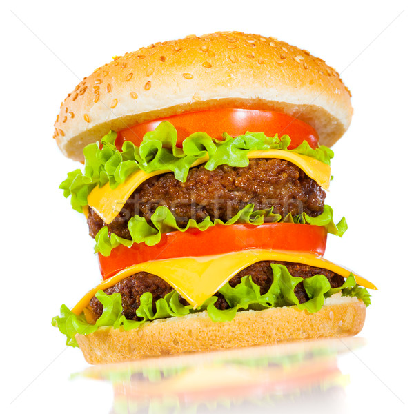 Tasty and appetizing hamburger on a white Stock photo © cookelma