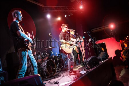 Band performs on stage in a nightclub Stock photo © cookelma