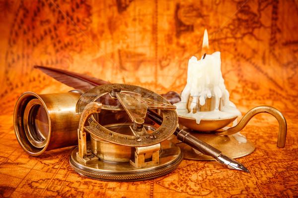Vintage still life. Vintage items on ancient map. Stock photo © cookelma