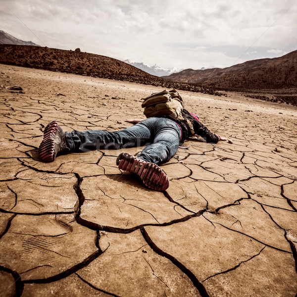 person lays on the dried ground Stock photo © cookelma