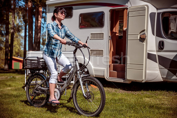 Woman on electric bike resting at the campsite Stock photo © cookelma