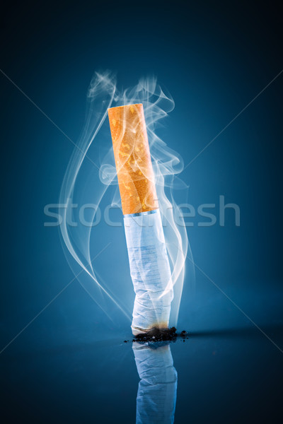 Stock photo: Cigarette butt - No smoking.