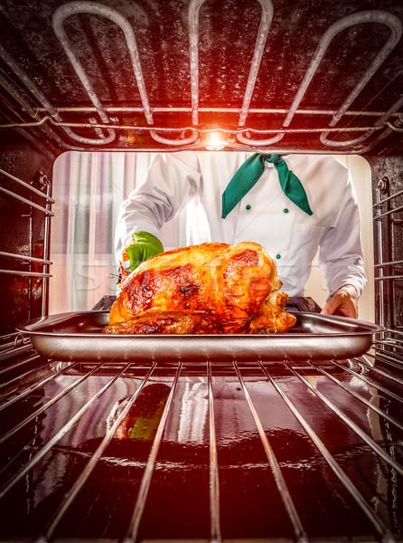 Főzés tyúk sütő szakács sült csirke kilátás Stock fotó © cookelma