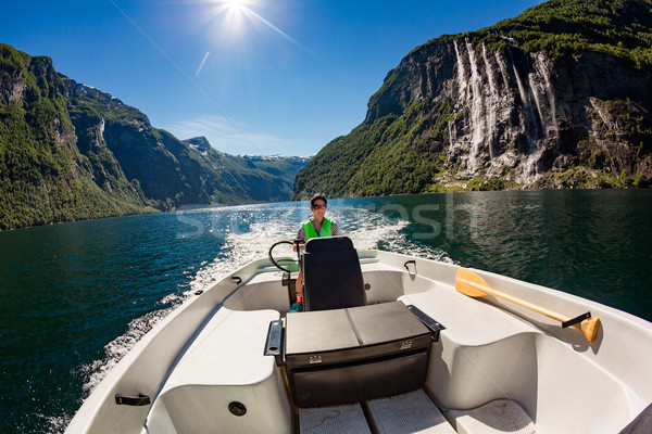 Woman driving a motor boat Stock photo © cookelma
