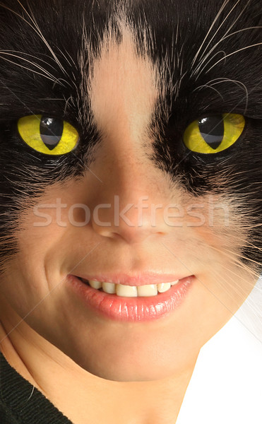 Catwoman with brightly yellow eyes Stock photo © cookelma