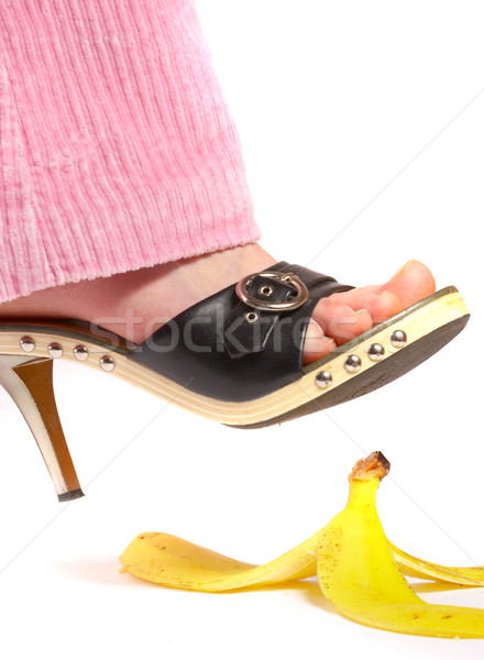 Female leg(foot) and peel of a banana. Life insurance. Stock photo © cookelma