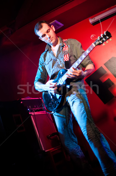 musician plays a guitar Stock photo © cookelma