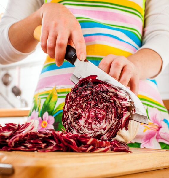 Woman's hands cutting red cabbage Stock photo © cookelma