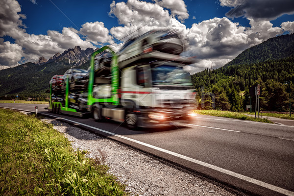 Truck trailer transports new cars rides on highway Stock photo © cookelma