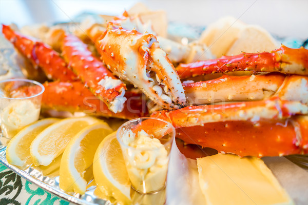 Red king crab legs with fresh lemon slices Stock photo © cookelma