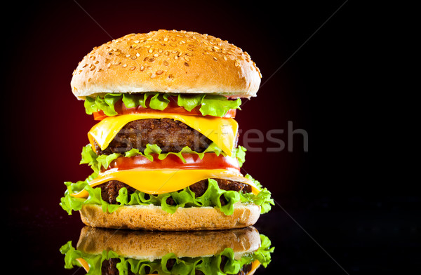 Tasty and appetizing hamburger on a darkly red Stock photo © cookelma