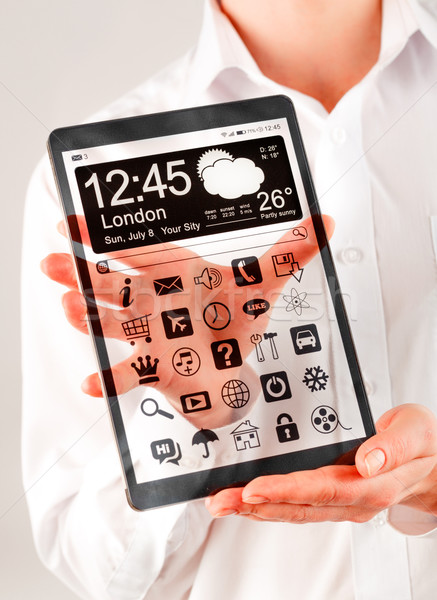 Tablet with transparent screen in human hands. Stock photo © cookelma