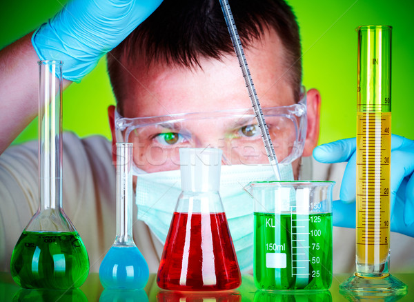 scientist in laboratory with test tubes  Stock photo © cookelma